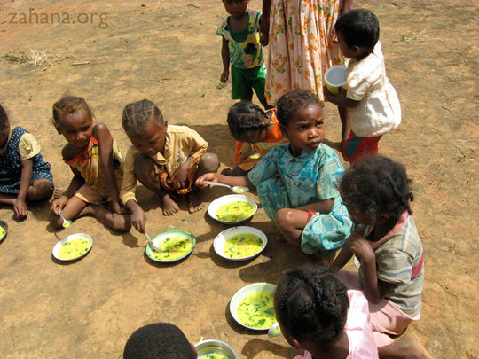 Children eating soup in the school