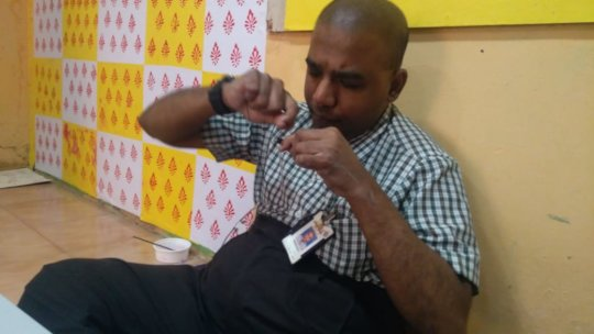 The Warli Artist now engaged in another task
