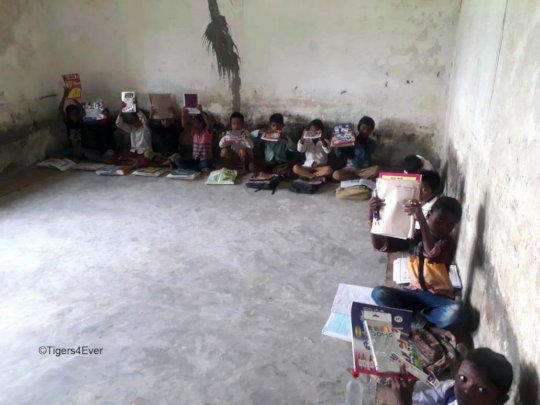"Children at one of the ""Pop-up Schools"" with their"