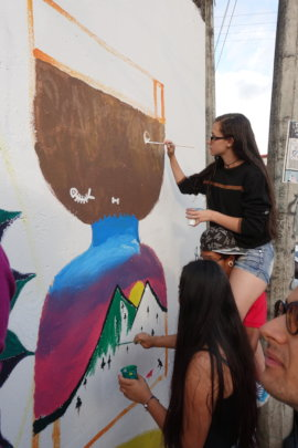 Young Girls painting anti-violence art