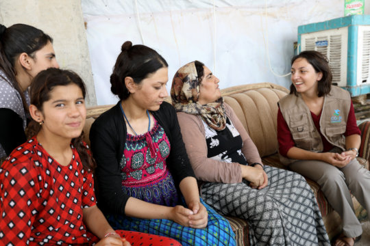 Francesca with an Iraqi family