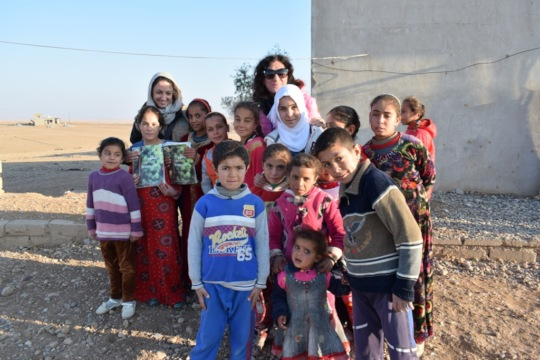 Francesca (on the left) with iraqi children
