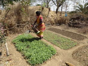 A Mother Watering the Kitchen Garden