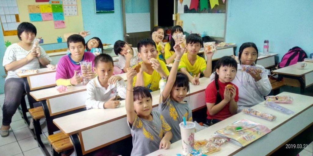 Children eat bread happily