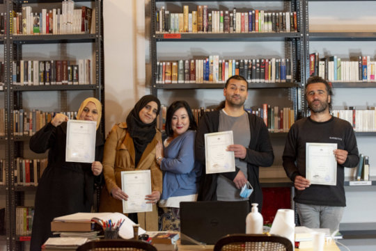 Posing with teacher and hard earned certificates!