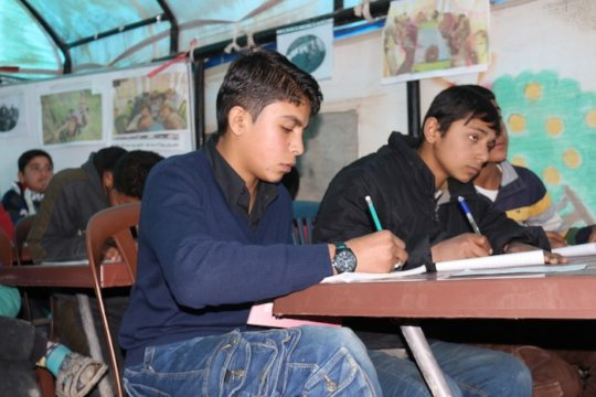 Ahmad, left, and his fellow students  UNICEF