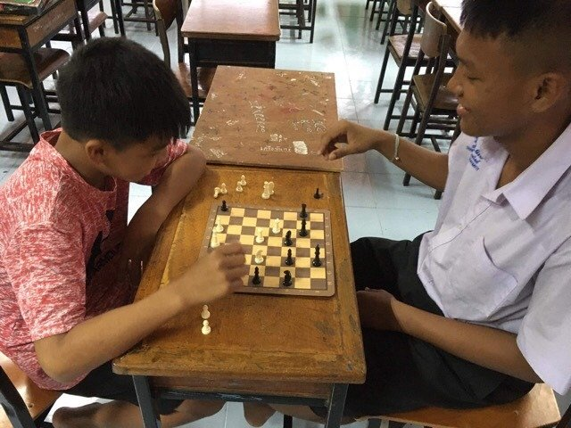 Playing Chess at Coconut Club