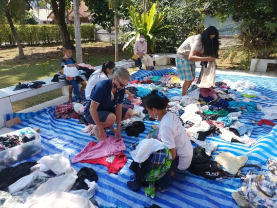 Giving second hand clothing to those in need