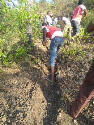 Community involvement digging the trenches