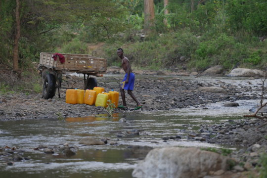 Collecting water using a wagon to assist