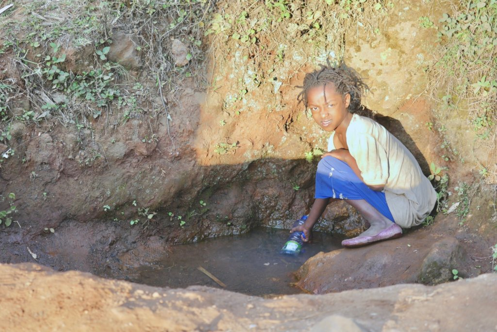 Young girl in Chano Dorga fetching needed water