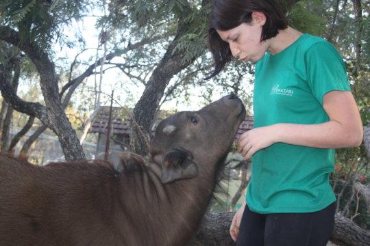 Chimoya and a volunteer