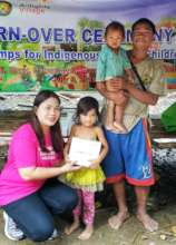 One of Mr. Bugkat's children receives a solar lamp