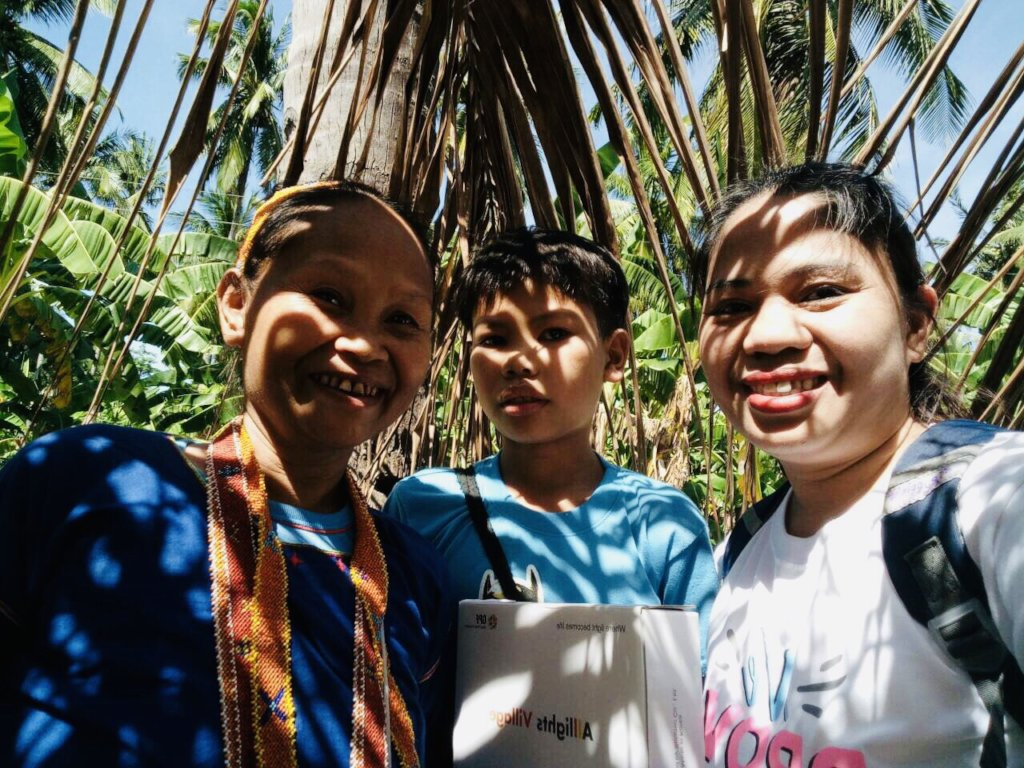 With a Mangyan child and his mother
