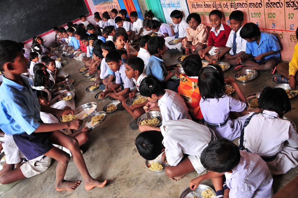 Children eating lunch - We feed over 1.2 million children DAILY in government run schools in India; helping to eradicate hunger and promote education simultaneously.