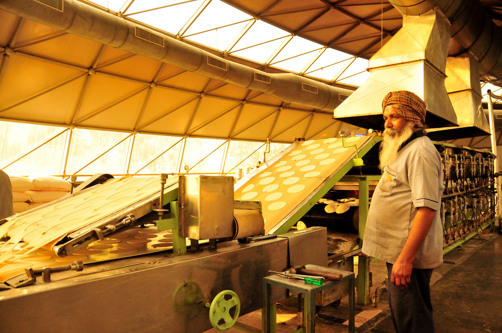 Innovative chapatti machine - Leveraging technology, Akshaya Patra prepares over a million fresh and nutritious meals daily. Our largest kitchen can produce 185,000 lunches in less than 5 hours