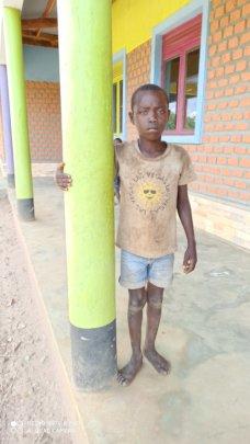 Okot outside his classroom