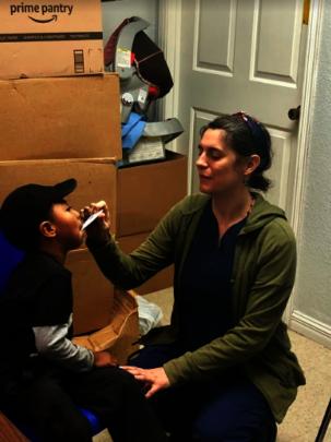 COHI Clinician Monica Treating Migrant Children