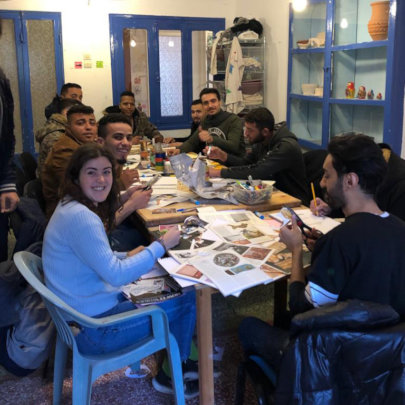 Teaching a collage art workshop at The Hub