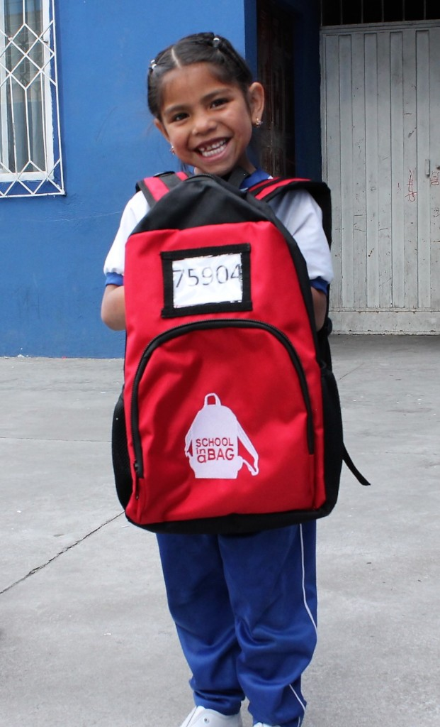 Receiving a new school bag!