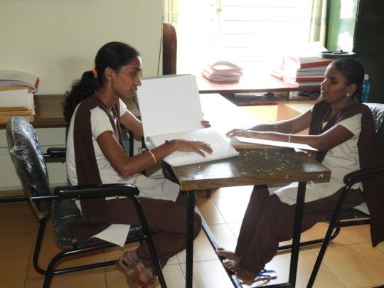 PU students - reading braille books at MitraJyothi