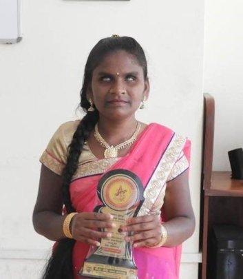 Vaishali holding Best Student Award proudly..