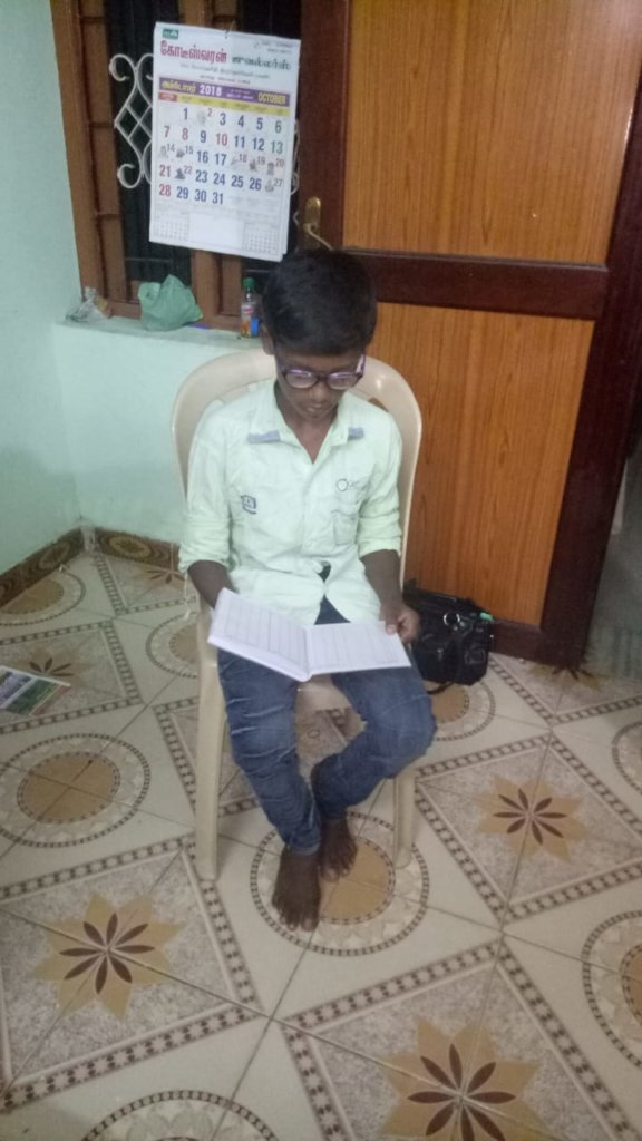 Low vision student, who was provided with specs
