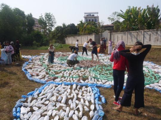 Students arranging plastic bottles