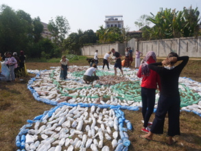 Students arranging plastic bottles