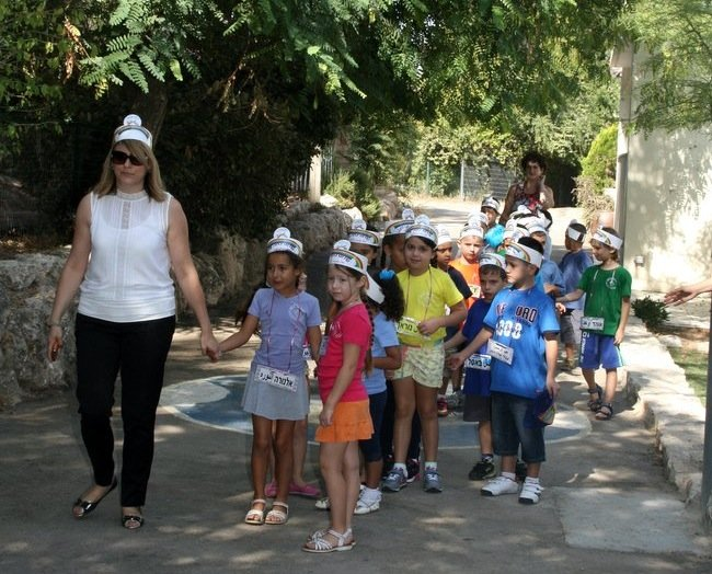 First graders enter their new school.