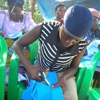 A sanitary pad sewing machine to a womens group