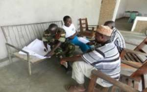 Soldier and civilians in a small group discussion.