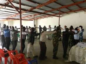 Closing circle during peace dialogue.