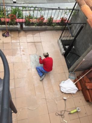Humberto repairing cracks/leaks and re-tiling