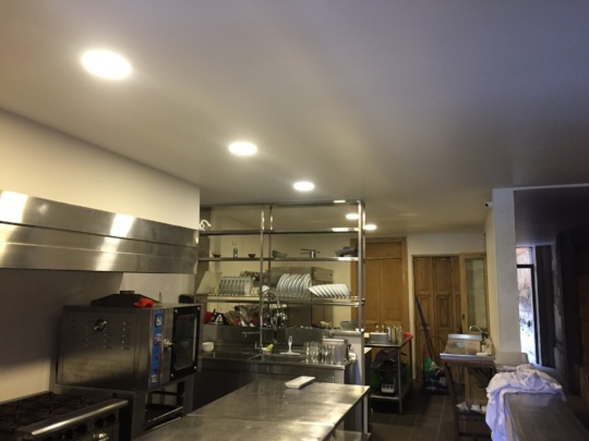 Finished kitchen ceiling, stainless steel station