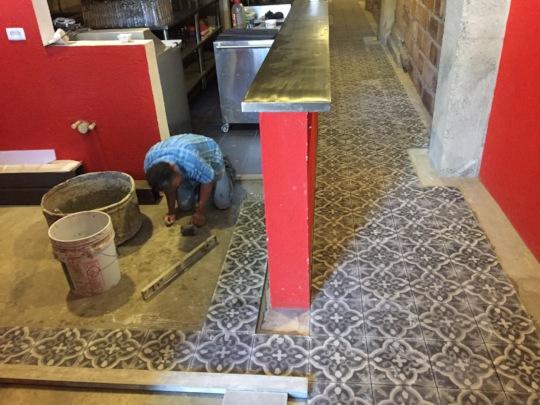 Humberto installing flooring