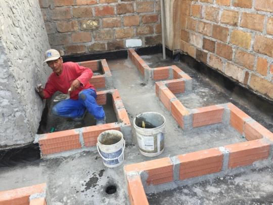 Humberto installing rooftop garden walls