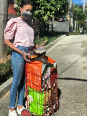 Karen delivering hot meals in Medellin