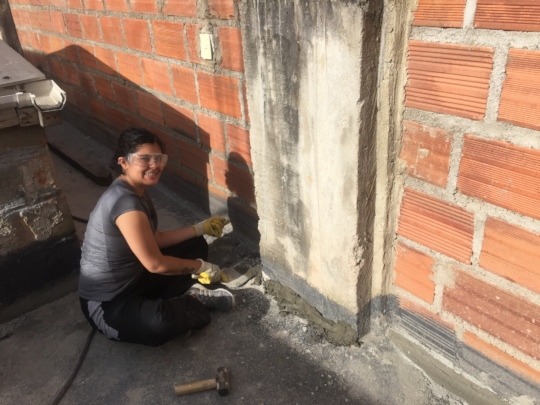 Tatiana prepping the roof for waterproofing