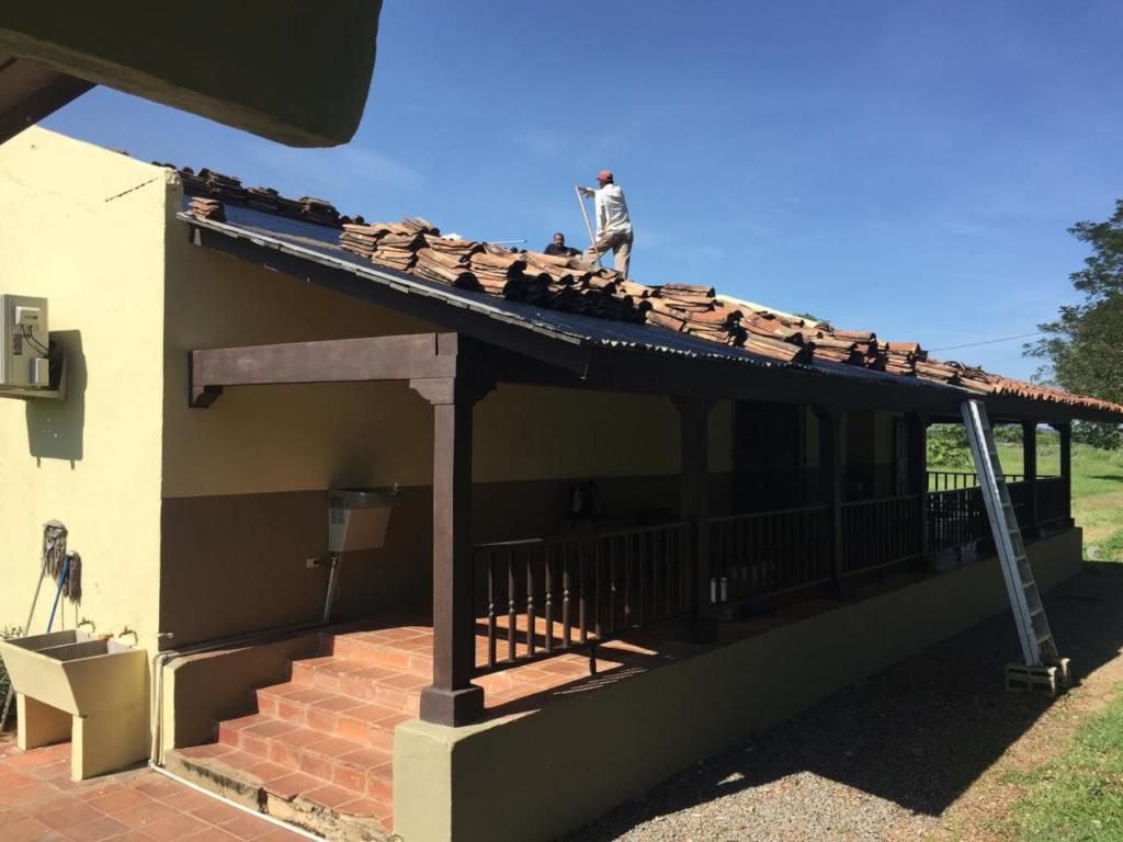 roof tiles being removed