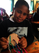 making frinedship bracelets with a cardboard loom