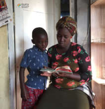 literacy volunteer reading with a child