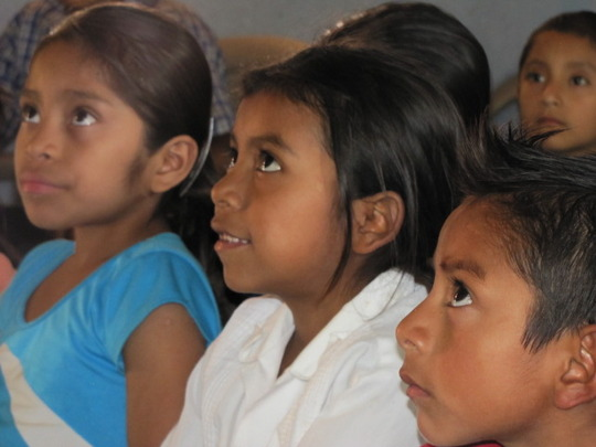 Girls participating in a story hour.