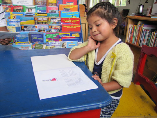 Elena is reading at age four in Guatemala