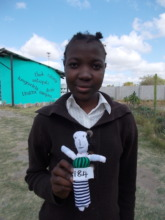 Langilihle posing with her handmade doll in 2015