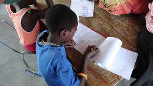 Children designing murals for the inside walls
