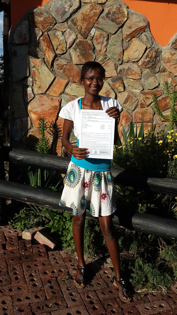 Sibahle proudly holds her Advanced Level report