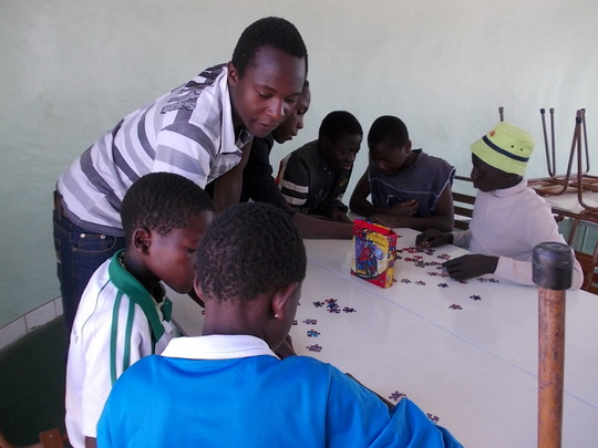 Collen working with kids on puzzles