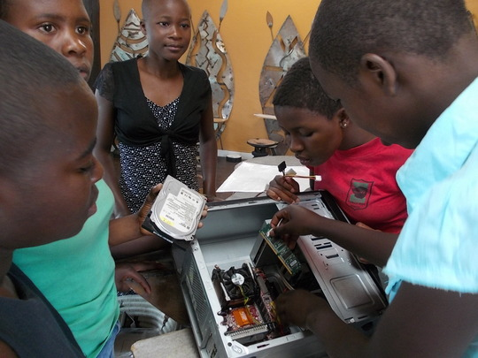 Girls learning about computer innards!