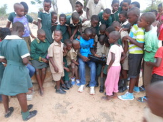 Nkosi introduces computer to kids at outreach